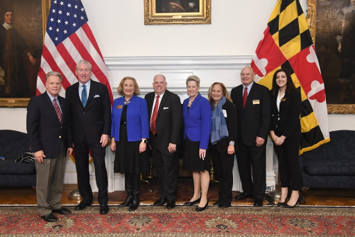 6 people holding certificates stand with Maryland Governor Larry Hogan and State Superintendent of Schools Dr. Karen B. Salmon