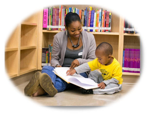 Adult with Child in Library Reading