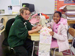 Students sew quilts for Project Linus to be given to children in the hospital.